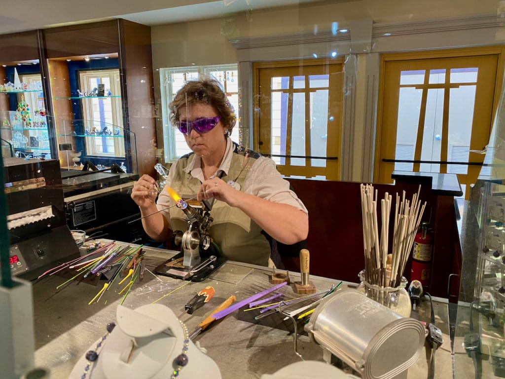 Glass Artist blowing glass at Arribas Brothers in Disney Springs